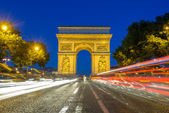 Arc de Triomphe in Paris , France. Arc de Triomphe at night with light trails Stock Images