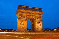 Arc de Triomphe in Paris, France. Night scene at the Champs Elysees with the Arc de Triomphe Royalty Free Stock Photos