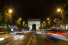 Arc de Triomphe in Paris. PARIS, FRANCE - 28TH JULY 2016: The Arc de Triomphe in Paris at night. The blur of traffic can be seen Stock Photo