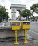 Arc de Triomphe, Paris, France. The Arc de Triomphe,on the Champs-Elysees in Paris, France. In foreground are postal mail boxes Stock Images