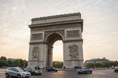 Arc de Triomphe. In Paris, France with traffic around it Stock Photo