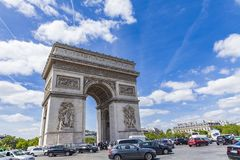 Arc de Triomphe in Paris, France. Traffic around Arc de Triomphe in Paris, France. It  is one of the most famous monuments in Paris Stock Image