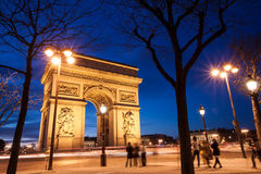 Arc de Triomphe, Paris, France. The Arc de Triomphe in Paris, France, at twilight with traffic light trails Royalty Free Stock Image