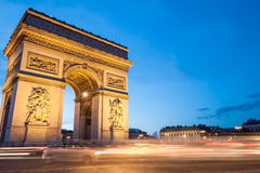 Arc de Triomphe, Paris, France. The Arc de Triomphe in Paris, France, at twilight with traffic light trails Stock Image