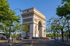 Arc de Triomphe in Paris , France. View of triumph arch under the blue sky Royalty Free Stock Photos