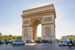 Arc de Triomphe in Paris , France. View of triumph arch under the blue sky Royalty Free Stock Photo