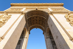 Arc de Triomphe in Paris , France. View of triumph arch under the blue sky Royalty Free Stock Images