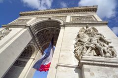 Arc de Triomphe, Paris. With French flag Royalty Free Stock Photography