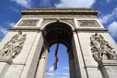 Arc de Triomphe, Paris. With French flag Stock Photo