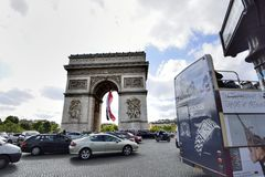 Arc de Triomphe, Paris. With French flag Royalty Free Stock Image