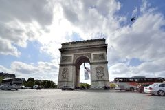 Arc de Triomphe, Paris. With French flag Royalty Free Stock Photos