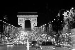 Arc de Triomphe, Paris. Illuminated avenue Champs Elysees by night. Cars traffic Stock Photo