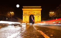 The Arc de Triomphe in Paris. Illuminated at night Stock Image