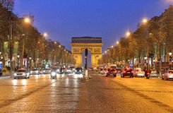 Arc de Triomphe, Paris. The Arc de Triomphe de l'Étoile  is one of the most famous monuments in Paris. It stands in the centre of the Place Charles de Gaulle Stock Photo