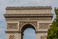 Arc de Triomphe, Paris. The Arc de Triomphe de lEtoile, Triumphal Arch of the Star; is one of the most famous monuments in Paris, standing at the western end of Royalty Free Stock Photos