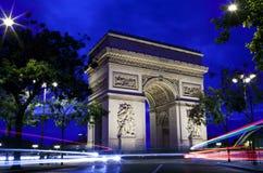 Arc de Triomphe in Paris. The magnificent Arc de Triomphe and light trails in Paris, France Royalty Free Stock Images