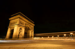 Arc de Triomphe, Paris, at Night. A long exposure, wide angle and almost abstract looking night shot of the Arc de Triomphe and traffic trails, Paris Stock Images