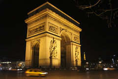Arc de Triomphe in Paris. By night Stock Photography