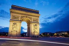 Arc de Triomphe in Paris at night, France. Arc de Triomphe in Paris at night cars passing, France Royalty Free Stock Photography