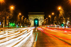 Arc de Triomphe in Paris at night Stock Photos