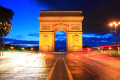 Arc de Triomphe, Paris. Arc de Triomphe at night with moving car lights, Paris Stock Photos