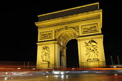 Arc de Triomphe, Paris. Night view of the famous Arc de Triomphe at Paris Stock Photo
