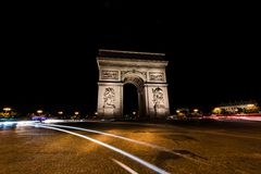 Arc de Triomphe Paris at night. View of the Arc de Tiomphe with traffic light at night Stock Photo