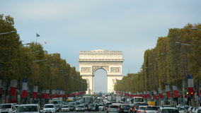 Arc de Triomphe in Paris seen from Champs Elysees on a sunny day with traffic stock video