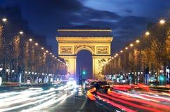 Arc de Triomphe Paris stad på solnedgången Arkivbilder