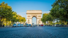 Arc de triomphe in Paris at sunset. In the summer Stock Photo