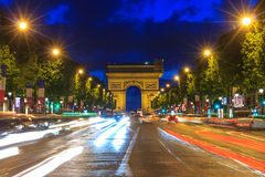 Arc de triomphe Paris at sunset. Arc de triomphe Paris (Arch of Triumph and Champs Elysees) at sunset Royalty Free Stock Image