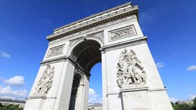 Arc de Triomphe Paris. Tourists under Arch of triumph time lapse. Arc de Triomphe at the western end of the Champs Elysees and at the center of Place Charles de stock video