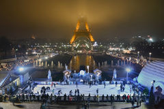 Arc de Triomphe. People ice skating at night in front of Eiffel Tower in Paris, France Royalty Free Stock Image