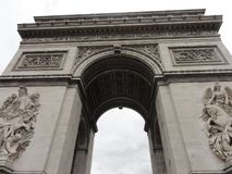 The Arc de Triomphe on the Place de l`Étoile - Paris - France. The Arc de Triomphe on the Place de l`Étoile often called simply the Arc de Triomphe, the Royalty Free Stock Image
