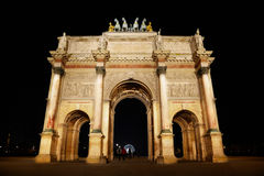 Arc de Triomphe at the Place du Carrousel. In Paris in the night Royalty Free Stock Photos