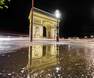 Arc de Triomphe and reflection at night. Night time in Arc de Triomphe and reflection over water pond Stock Image