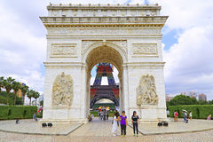 Arc de triomphe replica at window of the world, shenzhen, china. Visitors in front of replica of the world famous arc de triomphe, displayed at window of the Royalty Free Stock Image
