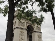 Arc de Triomphe - Seen aside. Arc de Triomphe between two trees. Seen aside, of day, outdoor and without character Stock Photography