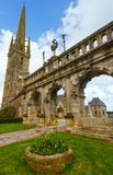 Arc de Triomphe in Sizun. Brittany, France. Arc de Triomphe and The Saint-Suliau church (16 th - 18 th) . Sizun, Brittany, France. Spring view Stock Photo