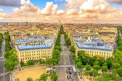 Arc de Triomphe skyline. Aerial view of Paris skyline from Arc de Triomphe at sunset light. Triumphal Arch with Place de l`Etoile and Avenue de Wagram road Stock Image