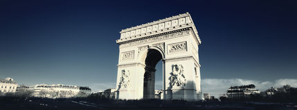 Arc de Triomphe spirit. Panoramic view of the Arc de Triomphe with special photographic processing Stock Image