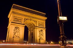 Arc de Triomphe and street plate. The Arc de Triomphe at night with a street plate in the foreground - Charles de Gaulle square,  Paris, France Stock Photos