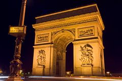 Arc de Triomphe and street plate. The Arc de Triomphe at night with a street plate in the foreground - Charles de Gaulle square,  Paris, France Royalty Free Stock Photos