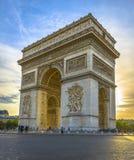 Arc de Triomphe at sunset. In Paris, France Stock Photos
