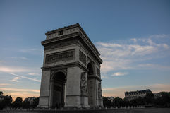 Arc de Triomphe at sunset in Paris, France. In Twilight light Royalty Free Stock Photography