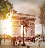 Arc de triomphe. Tourists around the arc de triomphe in paris Royalty Free Stock Photography