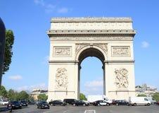 Arc de Triomphe. Traffic around Arc de Triomphe in Paris (France Stock Photo
