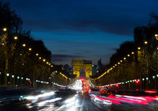 Arc de Triomphe and traffic. The Arc de Triomphe at the end of the Avenue des Champs-Elysees with the lights from traffic Stock Image