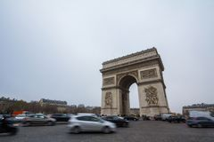 Arc de Triomphe triumph Arch on place de l`Etoile with a traffic jam of cars in front. PARIS, FRANCE - DECEMBER 19, 2017: Arc de Triomphe triumph Arch on place stock photos