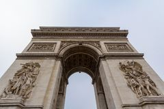 Arc de Triomphe Triumph Arch, or Triumphal Arch on place de l`Etoile in Paris, taken from below. It is one of the most famous monuments in Paris, standing at Royalty Free Stock Photos